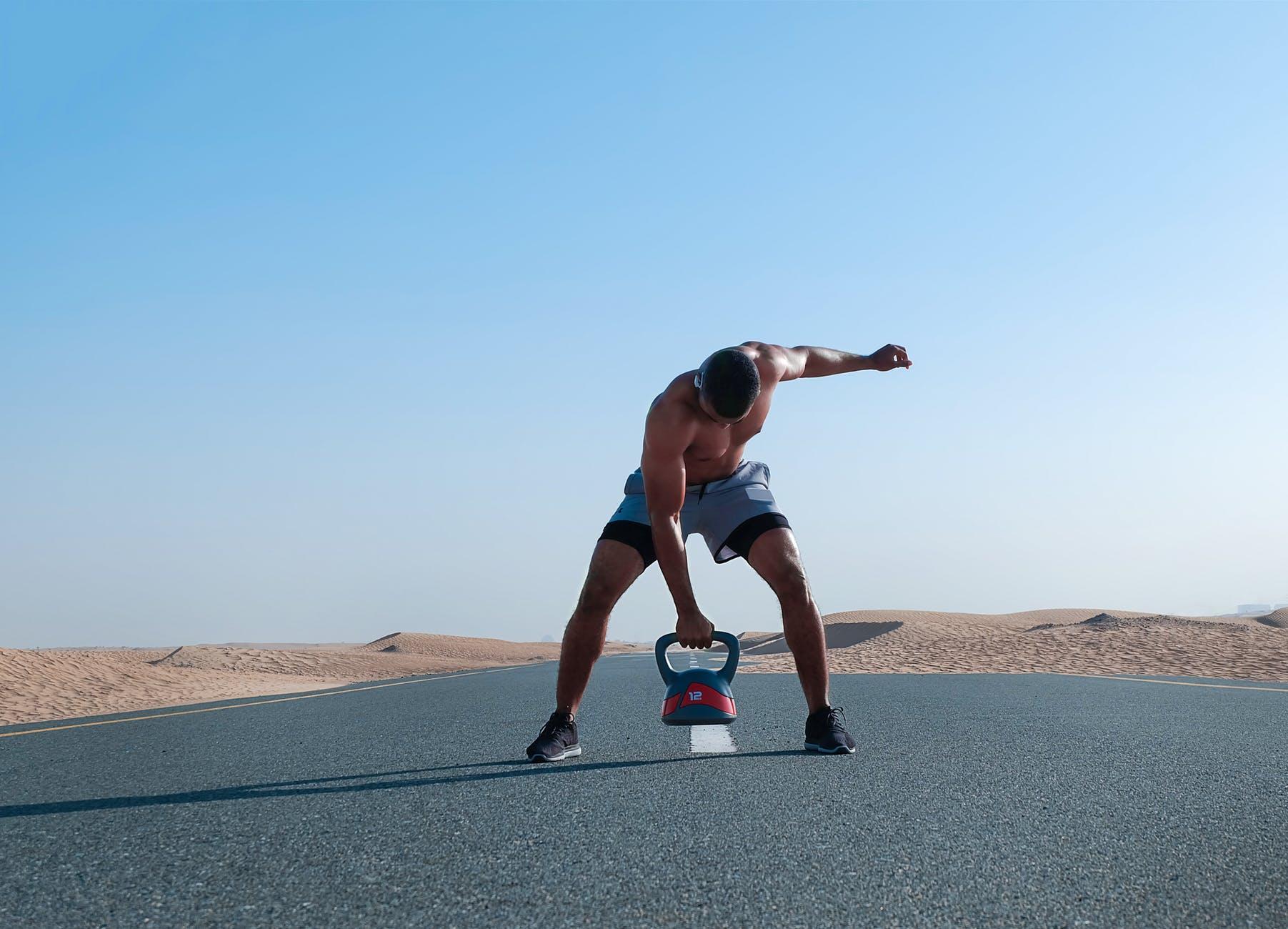 Man doing exercise using kettle