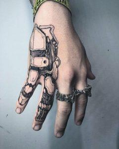 Extended finger tattoo for men