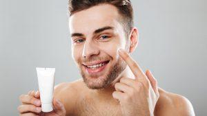 men holding a face cream