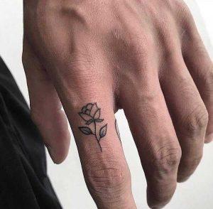 flower tattoo on finger for man